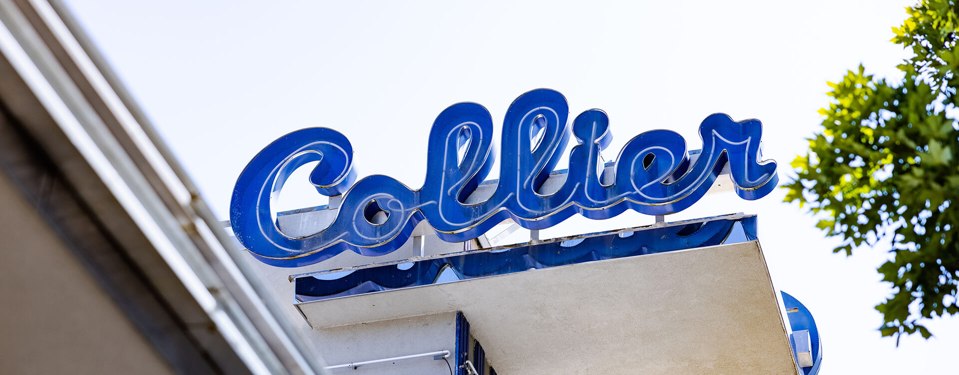 Photograph of the Collier Drug Stores logo signage
