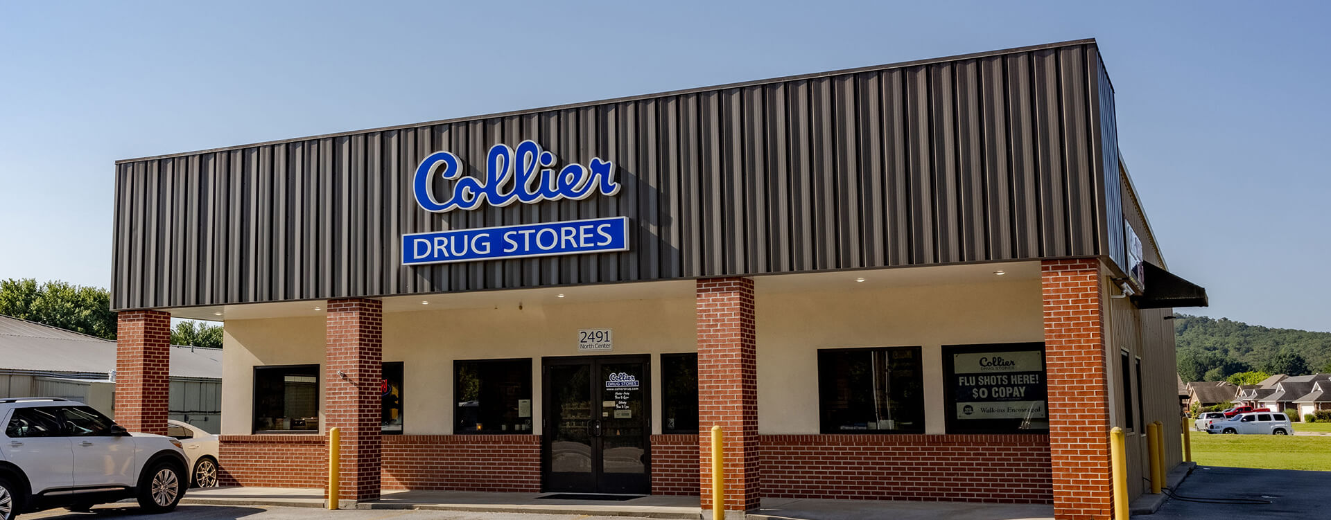 Photograph of Collier Drug Stores' Elkins location building